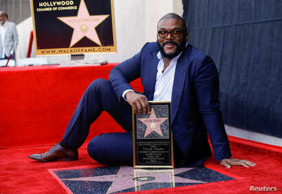 Movie mogul Tyler Perry poses on his star during its unveiling on the Hollywood Walk of Fame in Los Angeles, California, Oct. 1, 2019.