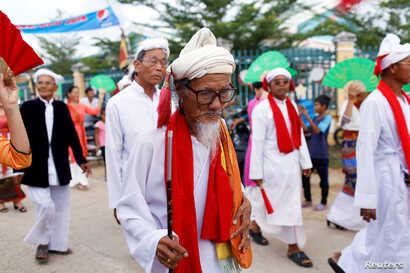 Vietnam's ethnic Cham religious leaders take part in a procession to the Po Klong Garai temple during the 'Kate' festival which marks the end of harvesting season in Phan Rang, Vietnam, Sept. 28, 2019.