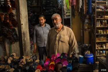 Yousuf Hamul, a 60-year-old cobbler says Syrian people are tired of fighting, but he feels it is not safe to suggest that he supports any side, Aug. 30, 2019 in Manbij, Syria. (VOA/Yan Boechat)