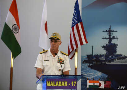 US Rear Admiral William Byrne speaks during the inauguration of joint naval exercises with India and Japan in Chennai on July…