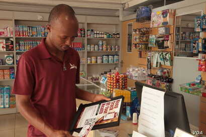 Andrew Quao, a co-founder of the healthcare tech startup, Red Bird works with pharmacies across Ghana, Nov. 13, 2019. (Stacey Knott/VOA)