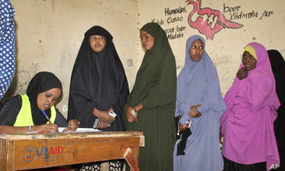 Women queue to cast their votes in the presidential election in Hargeisa, in the semi-autonomous region of Somaliland, in…