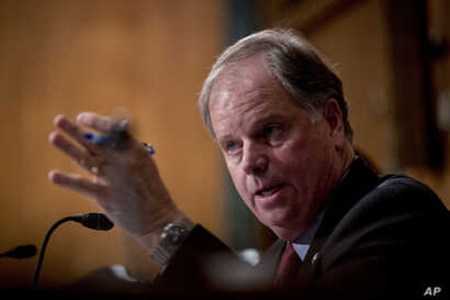 "Sen. Doug Jones, D-Ala., speaks at a Senate Banking Committee hearing on ""Housing Finance Reform: Next Steps"" on Capitol Hill,…"