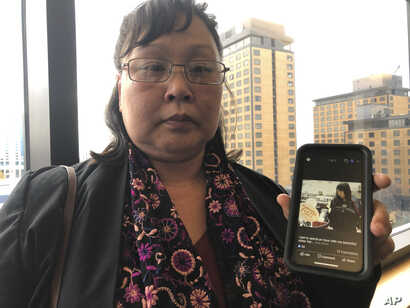 Rena Sapp, outside a courtroom Monday, Oct. 21, 2019, in Anchorage, Alaska, shows a photo of her sister, Veronica Abouchuk,…