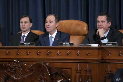 House Intelligence Committee Chairman Adam Schiff, D-Calif., center, flanked by Daniel Goldman, director of investigations