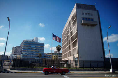 Tourists in a vintage car pass by the U.S. Embassy in Havana, Cuba, Nov. 7, 2019.