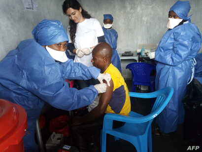 This handout picture released by Doctors Without Borders (MSF) Nov. 14, 2019, shows a man receiving his first injection of the new Ebola vaccine, at the MSF facilities in Goma, North Kivu province, DRC.