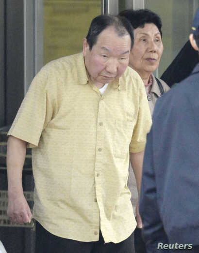 Death row inmate Iwao Hakamada (L), flanked by his sister Hideko, is released from Tokyo Detention House in Tokyo, in this photo taken by Kyodo, March 27, 2014.