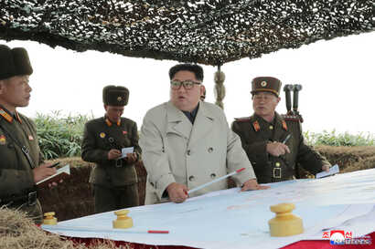 North Korean leader Kim Jong Un visits the Changrindo defensive position on the west front, in this undated picture released by North Korea's Central News Agency (KCNA), Nov. 25, 2019.