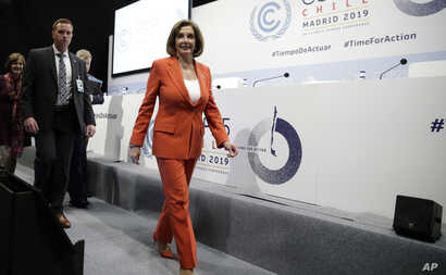 House Speaker Nancy Pelosi of Calif. arrives for a press conference at the COP25 climate talks summit in Madrid, Monday Dec. 2,…
