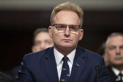 Acting Navy Secretary Thomas Modly testifies during a hearing of the Senate Armed Services Committee about about ongoing…