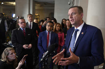 House Judiciary Committee ranking member Rep. Doug Collins, R-Ga., right, talks to reporters during a break in the House…