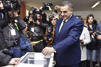 Presidential candidate Abdelaziz Belaid casts his ballot inside a polling station, in Algiers, Algeria, Thursday, Dec. 12, 2019…