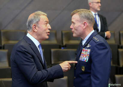 Turkey's Defence Minister Hulusi Akar and Supreme Allied Commander Europe (SACEUR) U.S. Air Force General Tod Wolters attend a…