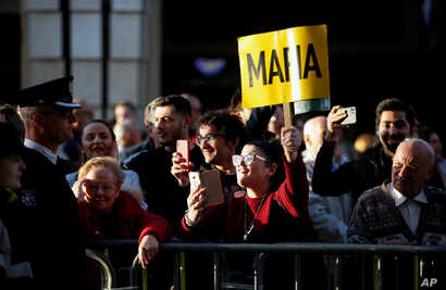 People attend a demonstration demanding justice over the murder of journalist Daphne Caruana Galizia, outside the Parliament in…