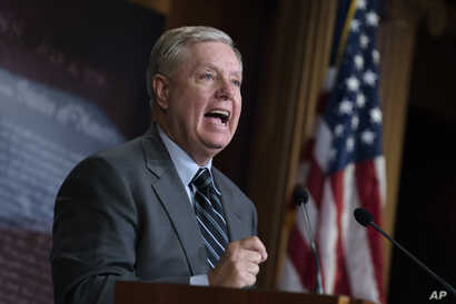Senate Judiciary Committee Chairman Lindsey Graham, R-S.C., denounces a report by the Justice Department's internal watchdog, on Capitol Hill in Washington, Dec. 9, 2019.