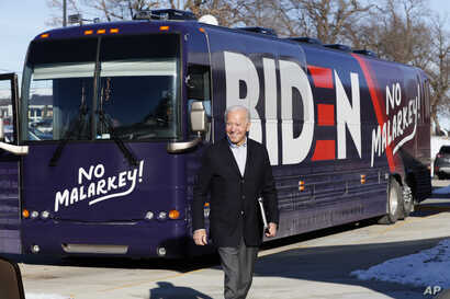 Democratic presidential candidate former Vice President Joe Biden arrives at a stop on his bus tour, Dec. 2, 2019, in Emmetsburg, Iowa.