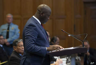 Gambia's Justice Minister Aboubacarr Tambadou addresses judges of the International Court of Justice for the first day of three days of hearings in The Hague, Netherlands, Dec. 10, 2019.