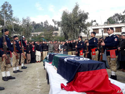 Pakistani police officers attend the funeral for their colleagues in Lower Dir, Dec. 18, 2019.