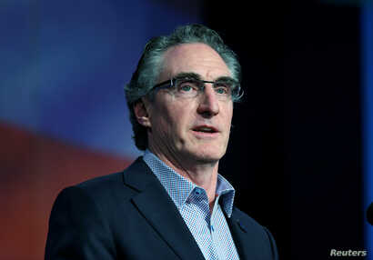 FILE - Governor Doug Burgum (R-ND) speaks to delegates at the Republican State Convention in Grand Forks, North Dakota, April 7, 2018.