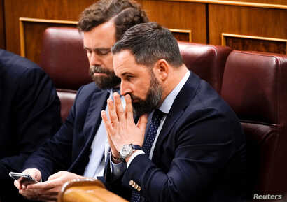 Santiago Abascal, leader of the Spanish far-right party Vox, reacts upon arrival at the first session of the Parliament following a general election in Madrid, Spain Dec. 3, 2019.