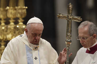 Pope Francis presides over a Mass for the solemnity of St. Mary at the beginning of the new year, in St. Peter's Basilica at…