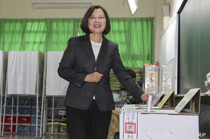Taiwanese President and presidential election candidate Tsai Ing-wen casts her ballot at a polling station in New Taipei City, Taiwan, Jan. 11, 2020.