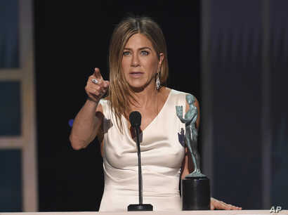 "Jennifer Aniston accepts the award for outstanding performance by a female actor in a drama series for ""The Morning Show"" at…"