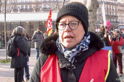 Nathalie Wiseur, 52, says she's demonstrating to ensure future generations get the same benefits she has, in Paris, Jan 24, 2020. (LIsa Bryant/VOA)