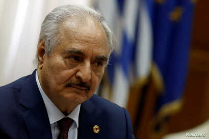 Libyan commander Khalifa Haftar meets Greek Prime Minister Kyriakos Mitsotakis (not pictured) at the Parliament in Athens,…