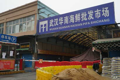 The Wuhan Huanan Wholesale Seafood Market, where a number of people fell ill with a virus, sits closed in Wuhan, China, Jan. 21, 2020.