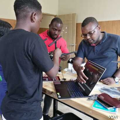 Instructors are seen teaching students at the African Drone and Data Academy in Malawi. (Lameck Masina/VOA)