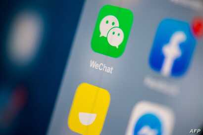 This illustration picture taken on July 24, 2019 in Paris shows the logo of the Chinese instant messaging application WeChat on…