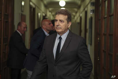 Greek Public Order Minister Michalis Chrisochoidis, arrives to participate on the first cabinet meeting of the new government,…