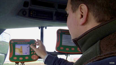 Jerome Regnault consults his GPS. Technology and markets are increasingly driving his business. (Lisa Bryant/VOA)