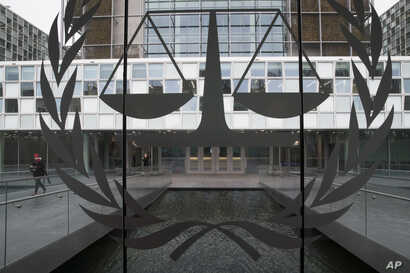 FILE - A person leaves the International Criminal Court in The Hague, Netherlands, Jan. 16, 2019.
