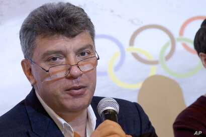 FILE - Boris Nemtsov, a former Russian deputy prime minister and opposition leader, presents a report claiming widespread corruption during preparations for the 2014 Winter Games in Sochi, at a news conference in Moscow, May 30, 2013.