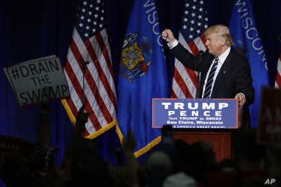 FILE - Republican presidential candidate Donald Trump campaign at the University of Wisconsin Eau Claire, Nov. 1, 2016, in Eau Claire, Wis.