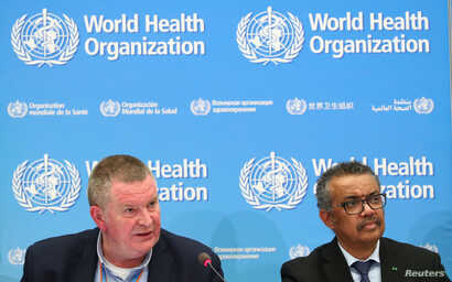 Michael J. Ryan, Executive Director of the WHO Health Emergencies Program and Director-General of the WHO Tedros Adhanom Ghebreyesus, attend a news conference on the coronavirus (COVID-2019) in Geneva, Switzerland, Feb. 24, 2020.