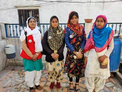 The girls who made it to college despite facing odds in their village homes are now spreading the message in their villages about the importance of educating girls. From left: Shahnaz Bano, Arastoon, Anjul Islam and Rizwana. (Anjana Pasricha/VOA)
