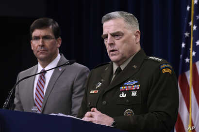 Defense Secretary Mark Esper, left, and Chairman of the Joint Chiefs of Staff Army Gen. Mark Milley, right, during a briefing…