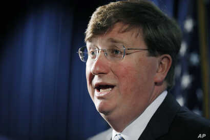 Republican Gov. Tate Reeves discusses the importance of establishing a task force on State Cybersecurity during a news…