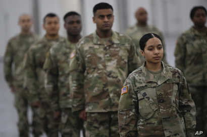 The National Guard stands in formation at the Jacob Javits Center, Monday, March 23, 2020, in New York. New York City hospitals…