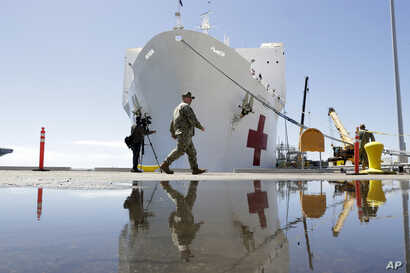 The USNS Mercy hospital ship is at dock before its departure Monday, March 23, 2020, in San Diego. The Navy hospital ship was…