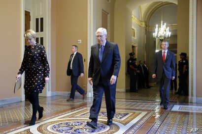 Senate Majority Leader Mitch McConnell of Ky. walks to the Senate chamber on Capitol Hill in Washington, Tuesday, March 24, 2020.