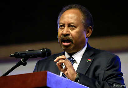 Sudan's Prime Minister in the transitional government Abdalla Hamdok addresses people as they celebrate the first anniversary…
