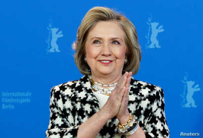 "Hillary Clinton gestures as she attends a photo call to promote the movie ""Hillary"" during the 70th Berlinale International…"