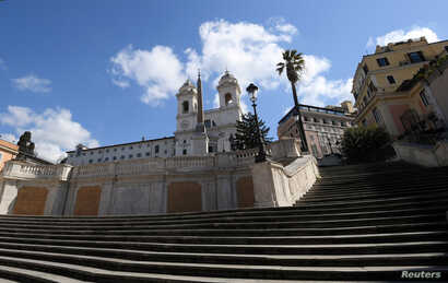 Rome's Spanish Steps are seen empty as Italy tightens measures to try and contain the spread of coronavirus disease (COVID-19),…