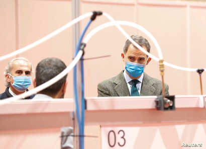 Spain's King Felipe VI visits a military hospital set up at the IFEMA conference centre during the coronavirus disease (COVID…