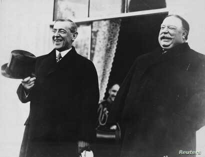 President-elect Woodrow Wilson and President Taft laugh on the White House steps before departing together for Wilson's…